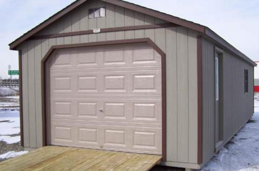 Gray Cottage Shed with a garage door by Yoder Building Company